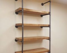 2 thick Rough Sawn wood Pipe Shelving with 2 thick / reclaim wood pipe shelves Decor, Wood Shelves, Shelves, Shelving, Woodworking Projects, Reclaimed Wood, Wood, Industrial Shelving, Saw Wood