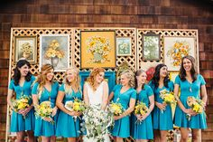 Bridesmaids in blue with wildflower bouquets