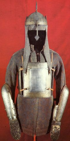 Indo-Persian  khula-khud (helmet), char-aina (chahar-aina, chahar a'ineh), literally the four mirrors, chest armor with four plates, dastanas/bazu band (vambrace/arm guards) retaining their covered hand guards, zirah (mail shirt)