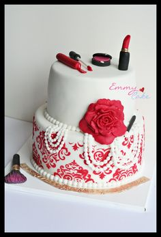 Makeup cake and she loves red - They wanted lots of red and makeup. She also liked pearls so i used that on the cake too