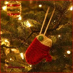 12 Days of Christmas: How to Crochet DIY Mitten Ornament by YARNutopia. In this tutorial I teach you how to make this mini mitten and turn it into an ornamen. Crochet Christmas Ornaments, Christmas Crochet Patterns, 12 Days Of Christmas, Christmas Crafts, Christmas Items, Red Heart Patterns, Crochet Gifts, Free Crochet, Xmas Tree