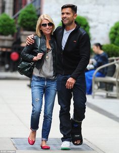 Mark Consuelos was seen sporting a walking boot while out with his wife Kelly Ripa ( NYC, May 14, 1014).  'Boot Cover Fashions tm'  designer medical boot covers are on their way (by CastCoverFashons.com)!