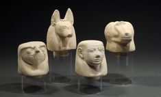 SET OF FOUR EGYPTIAN LIMESTONE CANOPIC JAR COVERS Depicting the four sons of Horus: Imsety (man), Qebsenuef, (falcon), Hapi (baboon), and Duamutef, (jackal).  XXIst-XXIInd Dynasty, 1069-712 BC  H. of Duamutef: 5 3/4 in. (14.6 cm.) H. of Hapi: 4 in. (10.1 cm.) H. of Imsety: 4 1/2 in. (11.4 cm.) H. of Qebseneuf: 4 1/8 in. (10.3 cm.)