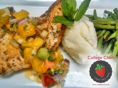 This spectacular seared chicken breast with mango, mint, and fresh-squeezed citrus salsa was served with roasted garlic potato quenelle and garlic-butter sautéed green beans. This meal was served to the Kappa Kappa Gamma girls at Drake University. #WeFeedtheGreek