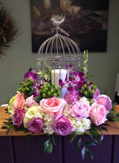 Garden World Florist - Bird Cage Table Arrangement with Fresh Flowers.