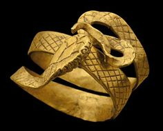 """Foto: A Roman gold snake ring circa 1st Century BC - 1st Century AD. The body incised with cross-hatching, the looped tail and head both curved inwards. Photo and description from Christie's. Many Roman pieces have much more """"finesse"""" than this vigorous, bold ring, which I find interesting to compare with e.g. Scythian pieces we have been looking at."""