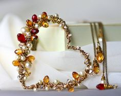 Pearls Burgundy and Champagne Crystal and Brass Wrapped Heart Lariat