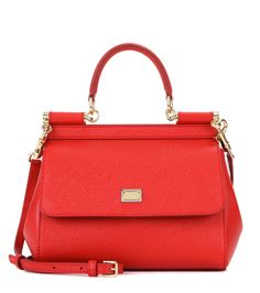 Dolce & Gabbana - Sicily Small  leather shoulder bag - Dolce & Gabbana's covetable Sicily bag is ladylike in this coveted romantic red hue. The classic smaller shape is finished with gold-tone accents for a timelessly glamorous look. For daytime, carry it next to pretty sun dresses or casual denim, swapping to a structured LBD come cocktail hour. seen @ www.mytheresa.com