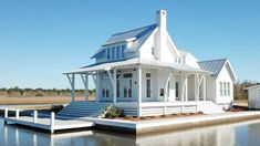 Looking for the best house plans? Check out the Loblolly Cottage plan from Coastal Living. Small Farmhouse Plans, Farmhouse Design, Farmhouse Style, Farmhouse Decor, Cottage Farmhouse, Small Lake Houses, Small Beach Cottages, Southern Living House Plans, Southern Cottage Homes