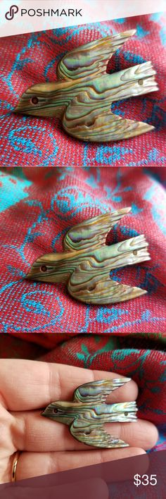 Vintage abalone Bird brooch sea shell dove pin This lovely vintage bird brooch is made of a hand carved rainbow Abalone sea shell. It has a pin back with a simple wire c clasp. This pretty bird is in very nice condition on the front, while the back has some age wear and verdigris to the metal, but still works fine! From a smoke free home:)    8988bird9z7e Vintage Jewelry Brooches