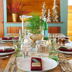 Put that dusty board game to good use! Here, we used the board as the centerpiece and set each place with monogrammed tiles. Top the board with a mini burlap-wrapped evergreen to finish the fun and creative look for the gathering.