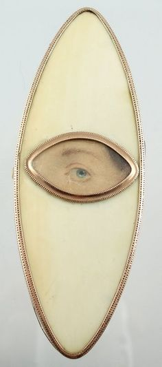 Georgian Lover's Eye, circa early 1800s. Oval ivory patch box with an eye miniature painted on card.