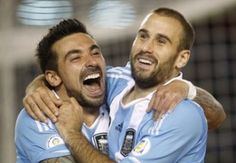 Argentina's Rodrigo Palacio celebrates after he scored their third goal against Peru during a 2014 World Cup qualifying soccer match in Buenos Aires