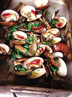 You can use all sorts of shellfish for this: razors, clams, mussels and queen scallops. Buy only tightly closed shellfish so you know they're still alive and fresh. If you've got bay, rosemary, thyme or, best of all, myrtle in your garden, whack branches on the embers to smoke underneath your shellfish. If your bars are wide apart, sit your shellfish on a baking rack so they don't fall through.