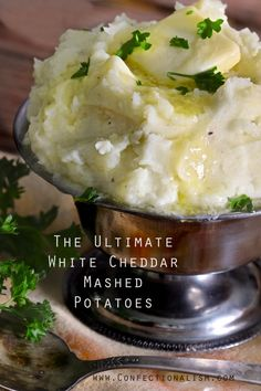 Confectionalism | The Ultimate White Cheddar Mashed Potatoes - These are soon good. Have to make these to go with the Ham for Easter.