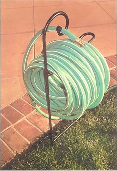 Garden Hose Horse by Metalfab, the hose slips off with minimal effort. Made of steel, with a rustproof, UV-resistant finish for extra durability. Holds 100 feet. $40