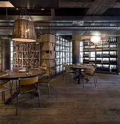 wine bar with industrial look decor | ... stools sit between the main bar and pizza bar private dining room via