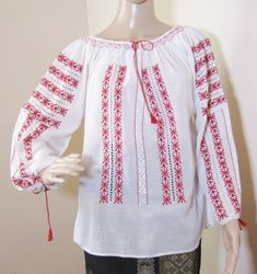 The colors and intricacy of a genuine Romanian peasant blouse, the beauty and the perfection of the Romanian embroidery are all that can complete your charm and chic. Raiders, Indiana Jones Costume, Marion Ravenwood, Peasant Blouse, Costumes For Women, Silk Top, Bell Sleeve Top, Tunic Tops, Blouses