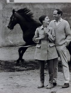 The actress Audrey Hepburn photographed with her husband Mel Ferrer by Pierluigi Praturlon in their villa near Rome (Italy), in January 1960. Audrey was wearing: • Coat: Hermès.
