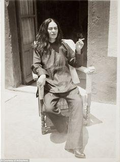 Frida Kahlo without her signature braid-do and indigenous clothing.