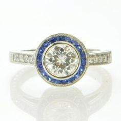 0.79 Carat Diamond and Sapphire Engagement Ring $4,499.00
