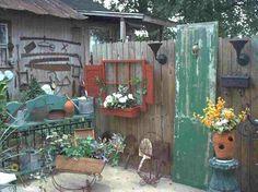 I especially like the red window/shutters/flower box.....  Garden Junk Room