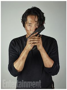 'Walking Dead': New EW Character Portraits, Glenn Rhee. Love this, Glenn is kissing his gun.