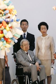 Japanese Prince Hitachi (C, foreground) and his wife, Princess Hanako, pose as they visit on 17.07.2014 in Paris, the exhibition dedicated to French painter Martial Raysse at the Centre Pompidou contemporary art center, also know as Beaubourg.