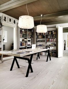Ideal huge desk, like the light color pallet, the book storage and the open/close connection with the other places in the house.