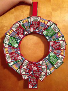 Homemade lottery wreath! All you need is a styrofoam ring, ribbon, pins, and scratch tickets!!