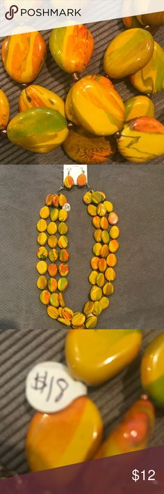 Necklace and earring set Beautiful necklace and earring set in golden yellow with hints of autumn brown, gold and green. Jewelry Necklaces