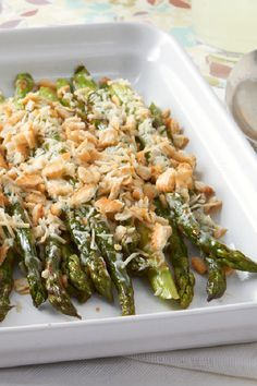 Easy Creamy Baked Asparagus – Add instant elegance to your party with this platter of fresh asparagus spears in a delicious cheese sauce and crumb topping. Talk about a delicious side dish recipe!