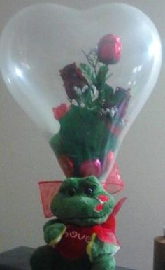 Chocolate roses inside heart shape balloons with plush toy. Great Valentines gifts.