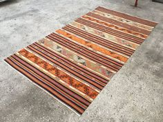 *This Anatolian Kilim made with natural wool in Middle of Turkey  It was weaved from Middle Anatolia, original size and pattern.  *We collected this kilim and full restored, professionally cleaned, repaired ready for use.  Materials: %100 Wool Stock Code: K-72  Size: 101 x 55   310 x 170 cm  *** If you want the back of the kilim we will addible canvas texture. FOR THIS SPECIAL ORDER, PLEASE WRITE TO INFORM***   ***ITS FREE FOR CHARGE***  All pictures are taken by daylighting in order to be…