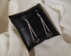 "Swing & sway loose with the beat, roll out on the town with these hematite loops that swing from silver chains and hang from silver-plated hooks.  Rock it out with jeans & heels, the slight bit of glitz for all your glam!      Hangs 1 ¾"" from hooks.    https://www.etsy.com/listing/115668763/downtown-swagger-earrings"