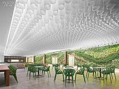 Interior Design Magazine: Hyundai Capital America in Atlanta designed by Gensler. A living plant wall supports different flowers and plants seasonally.