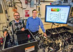 """Giacomo Coslovich (left) and Robert Kaindl (right) next to the laser setup that generates extremely short pulses of light at """"mid-infrared"""" ..."""
