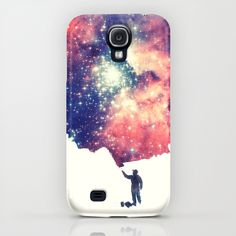 "We'd like that paintbrush too. ""Painting the universe"" by Badbugs_art makes for a beautiful phone case, available for the Samsung Galaxy and several generations of iPhone at Society6."