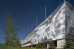 Poly Parkade Calgary Bing Thom punched metal screen