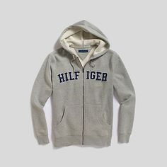 Tommy Hilfiger mens hoodie. Our heavyweight hoodie is one youll wear for years—on and off the field. • Classic fit.• 80% cotton, 20% synthetic. • Drawstring hood, appliqué, ribbed trim.• Machine washable. • Imported.