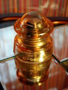 This is an absolutely stunning insulator.  The style by Hemingray was made during the 1930's, and is not often found in carnival glass. This early style has embedded brass bushing (the original metal sleeve) still inside the threads.  It is an amazing antique with truly historic value!