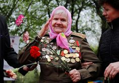 Russian war veteran Maria Udalova, 92, takes part in the celebrations on Victory Day - Moscow (2011) Maria is one of the few women to have outranked most men in terms of military achievements. During World War II, she participated in numerous campaigns and is noted for her participation in the defense of Leningrad. She lost her entire family in the conflict.
