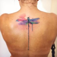 Dripping watercolor dragonfly tattoo by Bora Tattoo