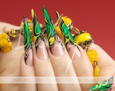 Green and yellow stiletto nails
