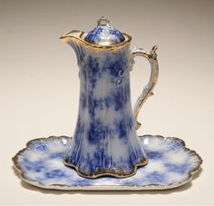 This is the perfect shade of flow blue. Warwick china flow blue coffee pot and tray.