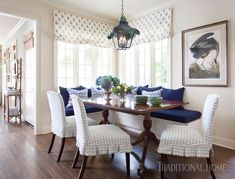 The dining nook is kid-friendly. The bench is slipcovered in indoor-outdoor fabric, and the table is mildly distressed so no worries—fork dents won't stand out. - Photo: Amy Bartlam and Ryann Ford / Design: Meredith Ellis
