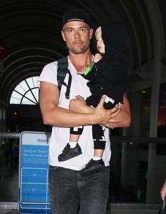 Fergie and Josh Duhamel arrive on a flight at LAX Airport with their son Axl on May 4, 2015