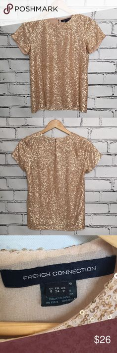 French Connection Rose Gold Sequin Top, Size 2 Nice pre owned condition! Beautiful top!! French Connection sequin Short Sleeve top. Size 2. No visible signs of wear. Button closure in back. Sheer layer underneath the sequin layer to prevent scratching. Open to offers, but no trades please. French Connection Tops Blouses