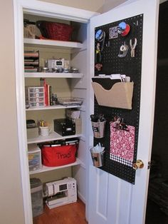 A peg board and a shoe organizer are smart ways to use the inside of a closet door. Attic Storage, Craft Storage, Door Storage, Storage Area, Office Storage, Closet Storage, Craft Closet Organization, Folder Holder, Pantry Makeover