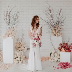 Fresh + Modern Whites and Spring Florals   Made With Love   Sadie by Made With Love Bridal   modern wedding inspiration   white brick ceremony site   fitted crepe wedding dress with cap sleeve, plunging neckline, low back and middle slit in skirt   modern minimalist wedding table scape   white orchids, white roses, pink roses, light orange roses and cherry blossom branches   floral forward wedding   modern texas venue   made with love sadie   #madewithlove #aandbebridalshop